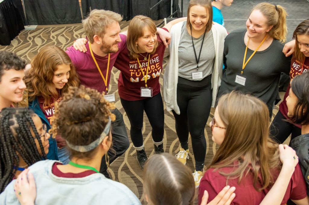 The 2019 Youth Planning Team in a group huddle.