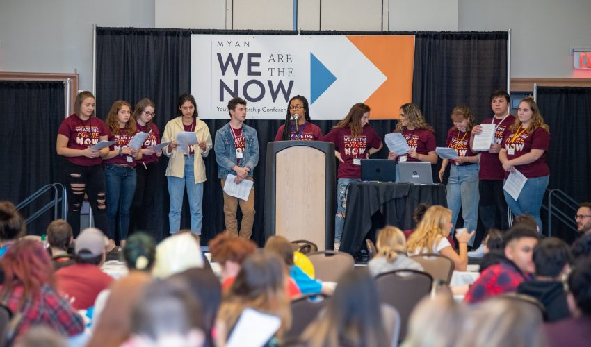 Picture of Youth Planning Team on stage at 2019 conference.